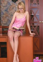 Nikki can't concentrate on a book and strips naked for some nasty nude posing in eye-glasses.