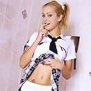 Dirty young college girl removes panties in toilet