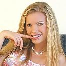 Blonde hottie gets naked in the bedroom