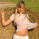 Teen girl in a field of hay