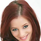 Fiery redhead teen removes panties and shows pink