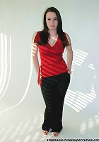 Steph poses in her red top in a studio