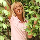 Adorable teen coyly strips by fence